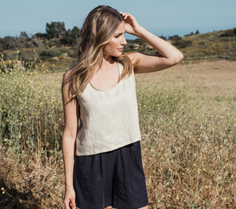 woman outside in sotela linen crop top and shorts