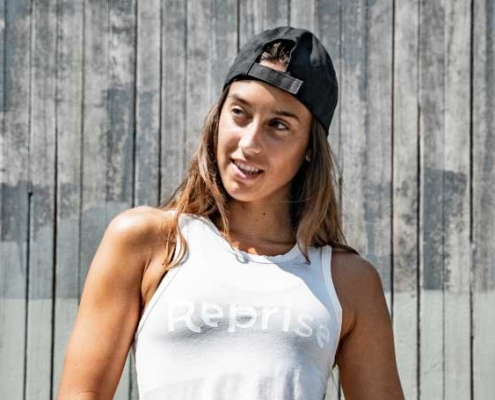 woman wearing reprise tencel tank top and organic cotton black hat